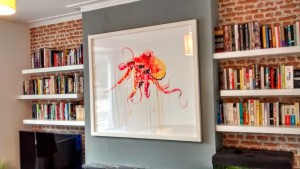A large Dave White artwork hung on above a chimney breast in Brighton