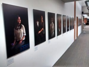 Twelve Women in Academia, A view of the complete series Installed at The University of Sussex.