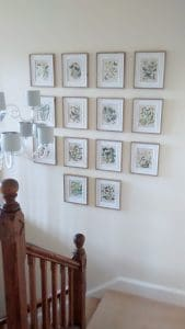 Two metre high grid of illustrations hung over stairs near Calne, Wiltshire.