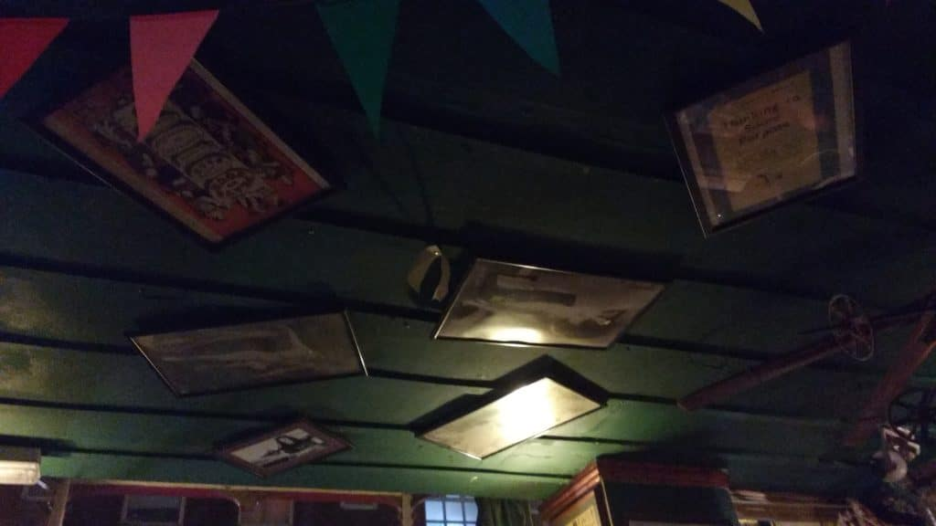 Pictures hung all over the ceiling at the Hand In Hand Pub, Kemp Town, Brighton