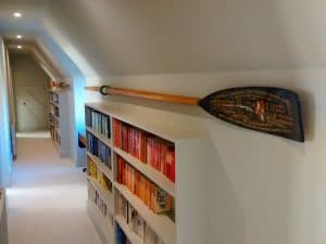 Keeping the hallway ship shape. A commerative rowing oar hung in a loft conversion near Grayshott, Hampshire.