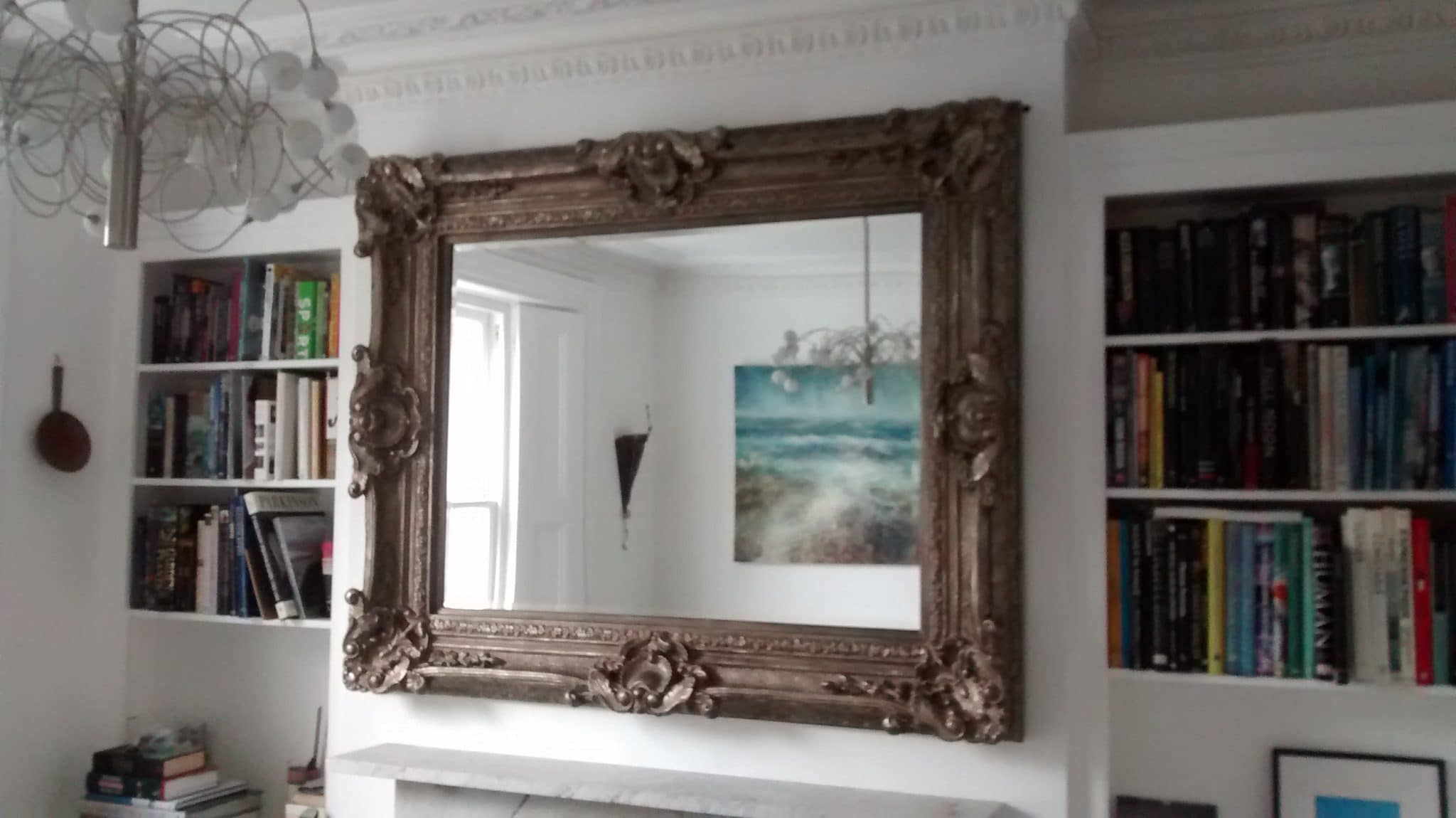 The picture hanger professional picture art and mirror hanging large baroque wood carved mirror hung on a chimney breast that breaks up amipublicfo Gallery