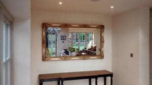 Large antique gold gilt mirror, hung in an alcove in Hertfordshire.