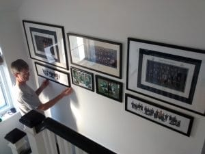 Here is Scott in the stairwell, installing a picture wall of the family school photos.