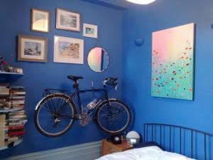 We also hang bikes! Picture arrangement incorporating bicycle installed in a bedroom in Lewes.