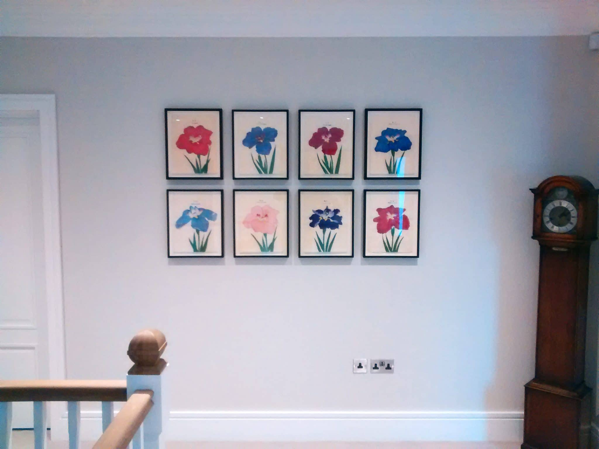 Arranging photos on a wall - Picture Wall Ideas Eight Japanese Flower Pictures Hung In A Grid Formation