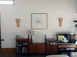 A minimal picture sits well amongst the furniture of the room.