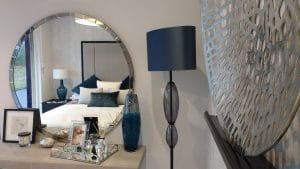 Bed rest, floating shelves and mirror installed in a care home showroom in Surrey.
