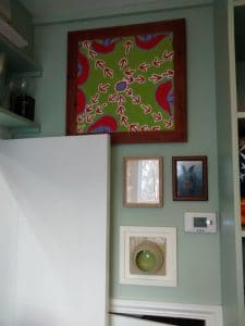 Pictures hung in a small utility room in Hampstead, London.