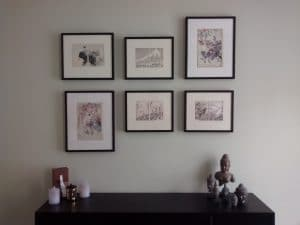 Six black framed prints hung in an asymmetrical grid.