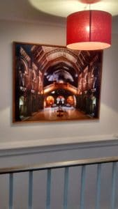 A large photograph of the natural history interior hung above stairs in Dulwich.