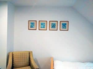 a row of four cat illustrations in an attic in Cobham, Surrey.