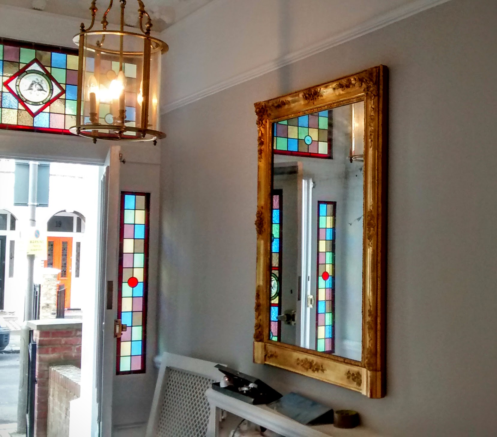 A gold decorated mirror hung in the hallway entrance of a home in Tunbridge Wells.