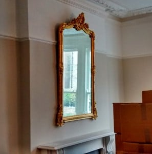 An ornate gilt framed mirror hung in a living room in Basingstoke.