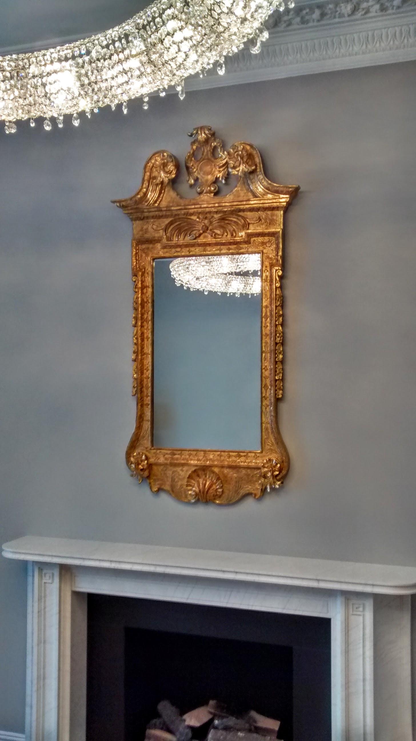 Ornate gilt framed antique mirror