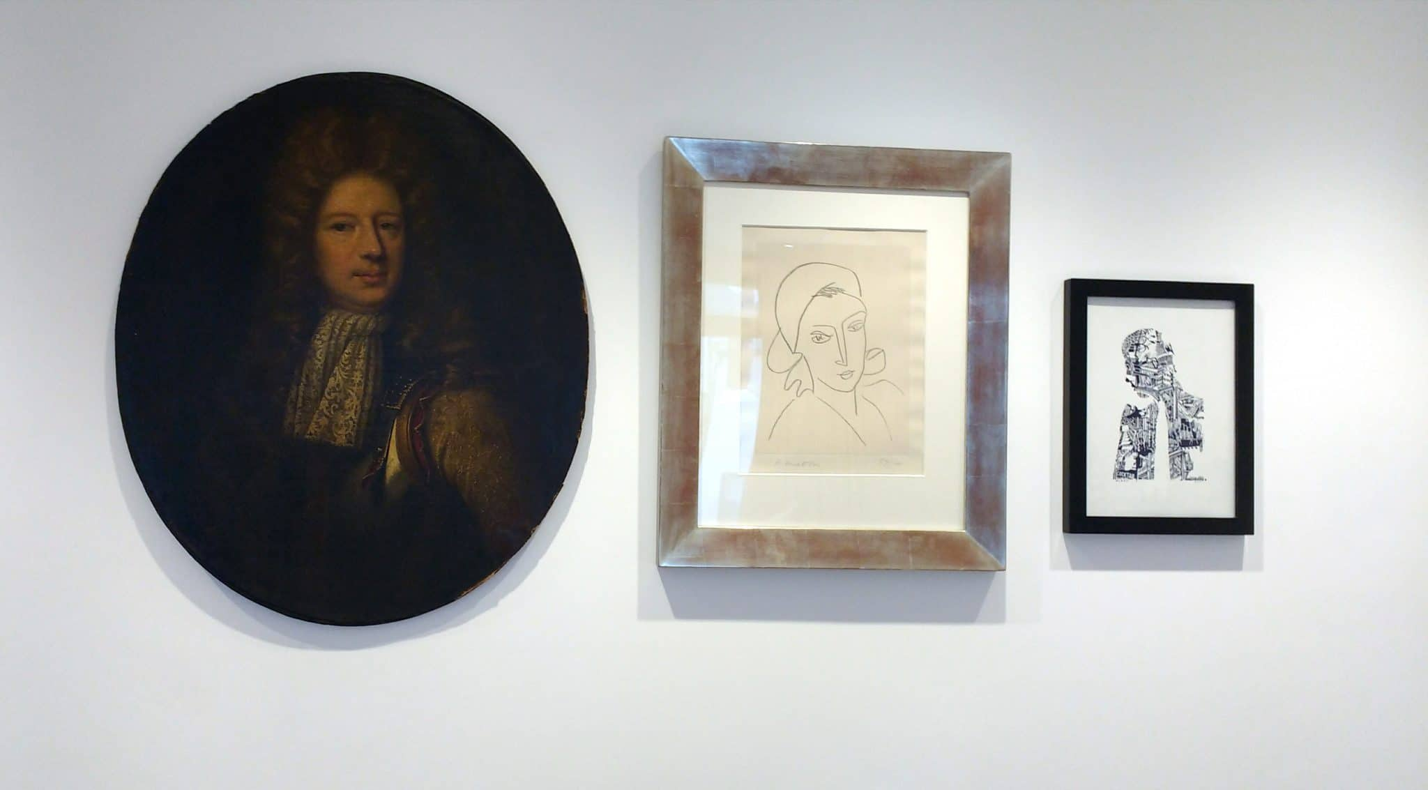 A trio of portraits, each from a distinctly different era and artist. Conversing through the ages, hung on a wall in a guest bedroom in in Kemp Town.