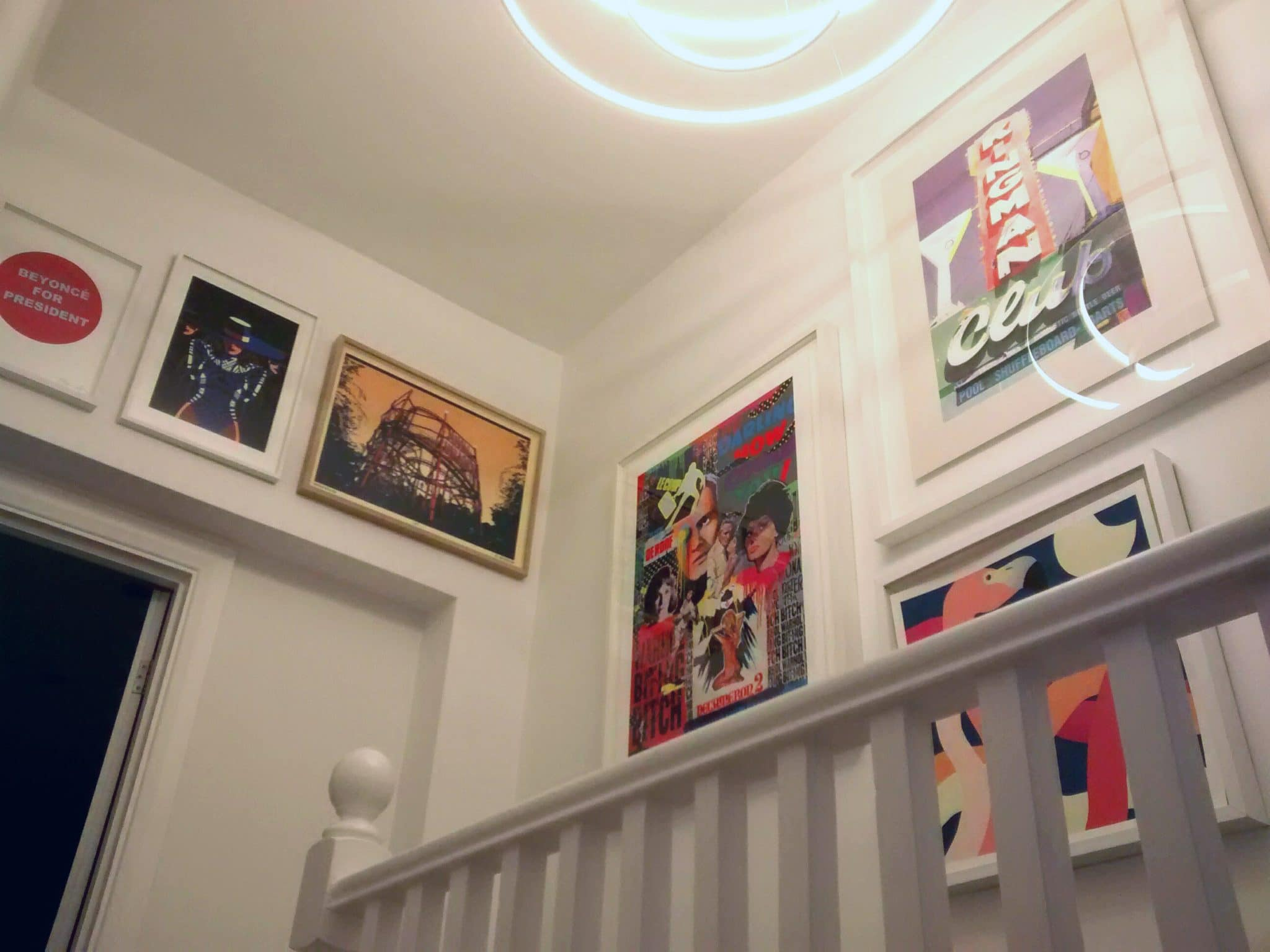 Bold block colours brighten up the banisters. Hung above stairs in a terraced house in Hackney, East London.