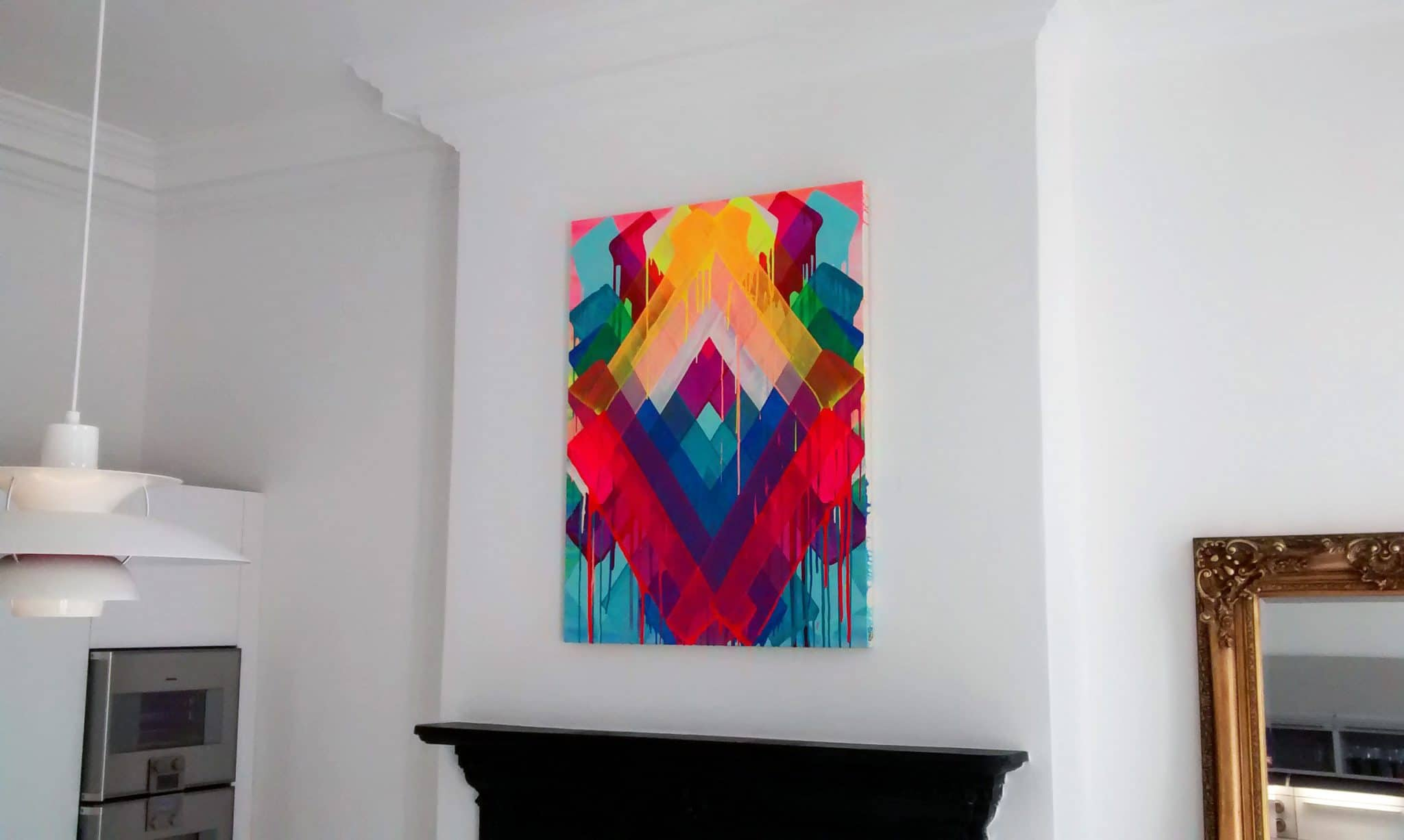 Vibrant neon canvas painting hung portrait, on a chimney breast in a living room in Haywards Heath.