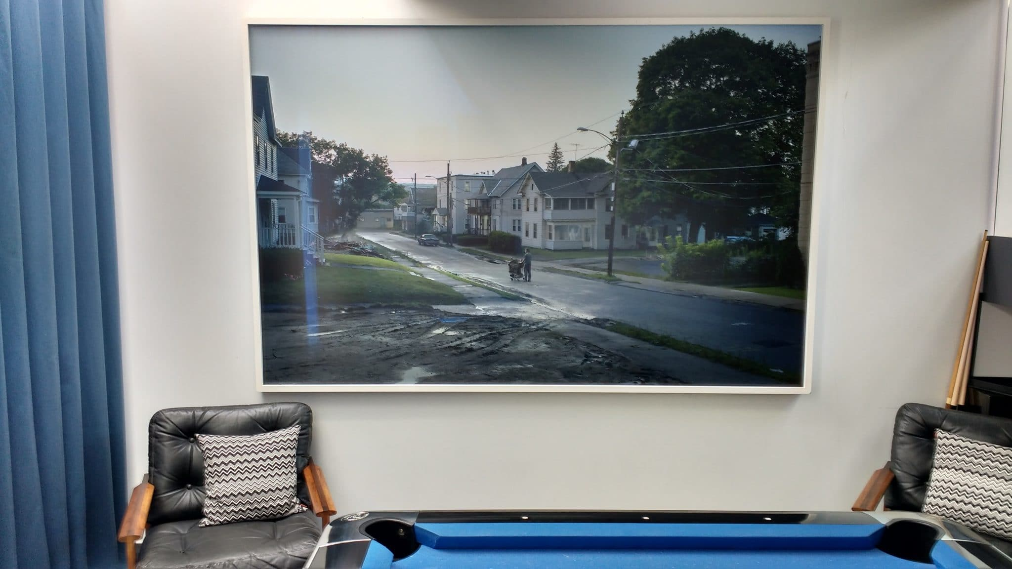 Large 1.5x2m photographic print hung by a blue pool table in Brighton.