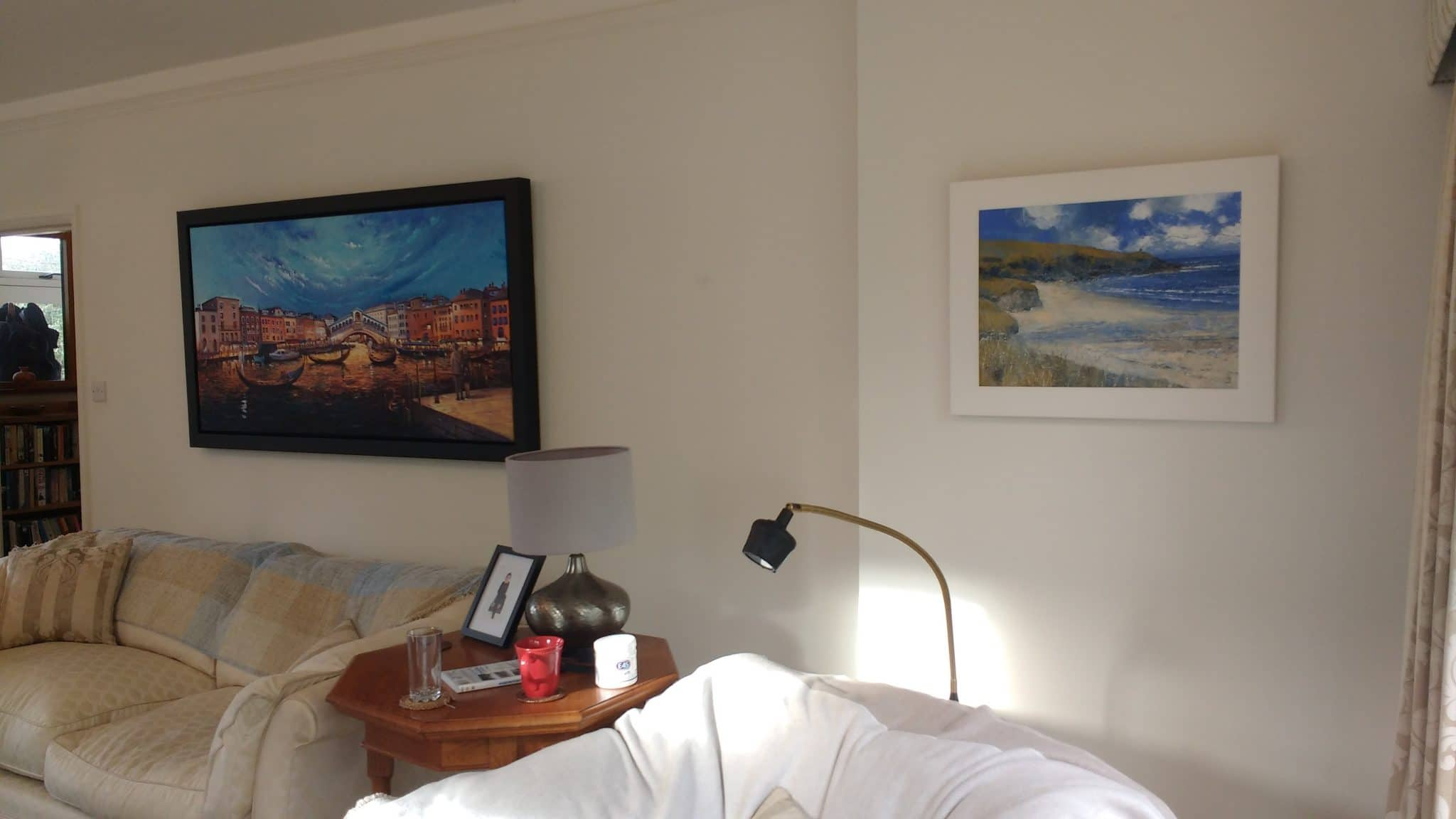 Two paintings in a living room in Leatherhead.