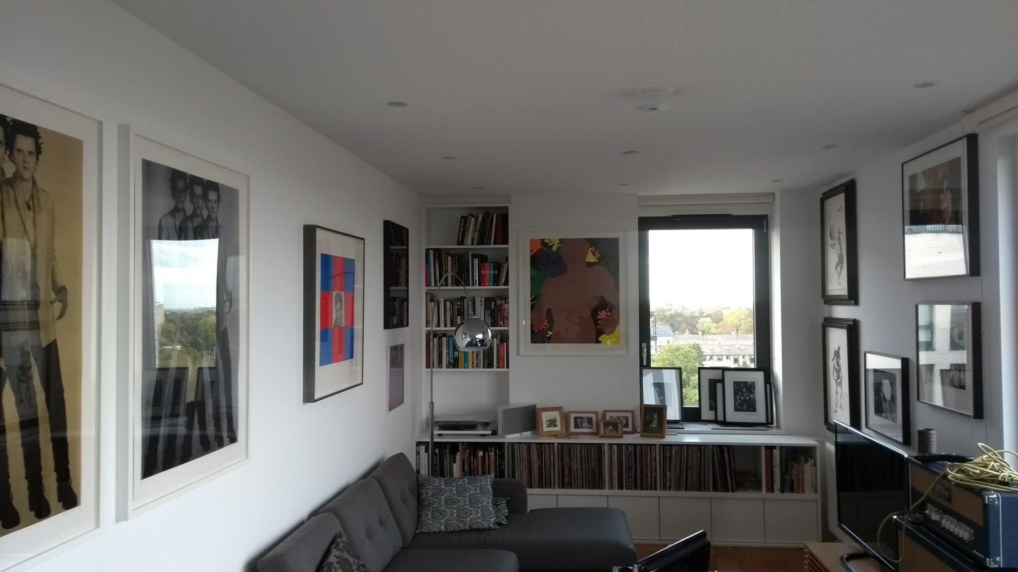 Large prints hung in a living room in Bethnal Green, London.