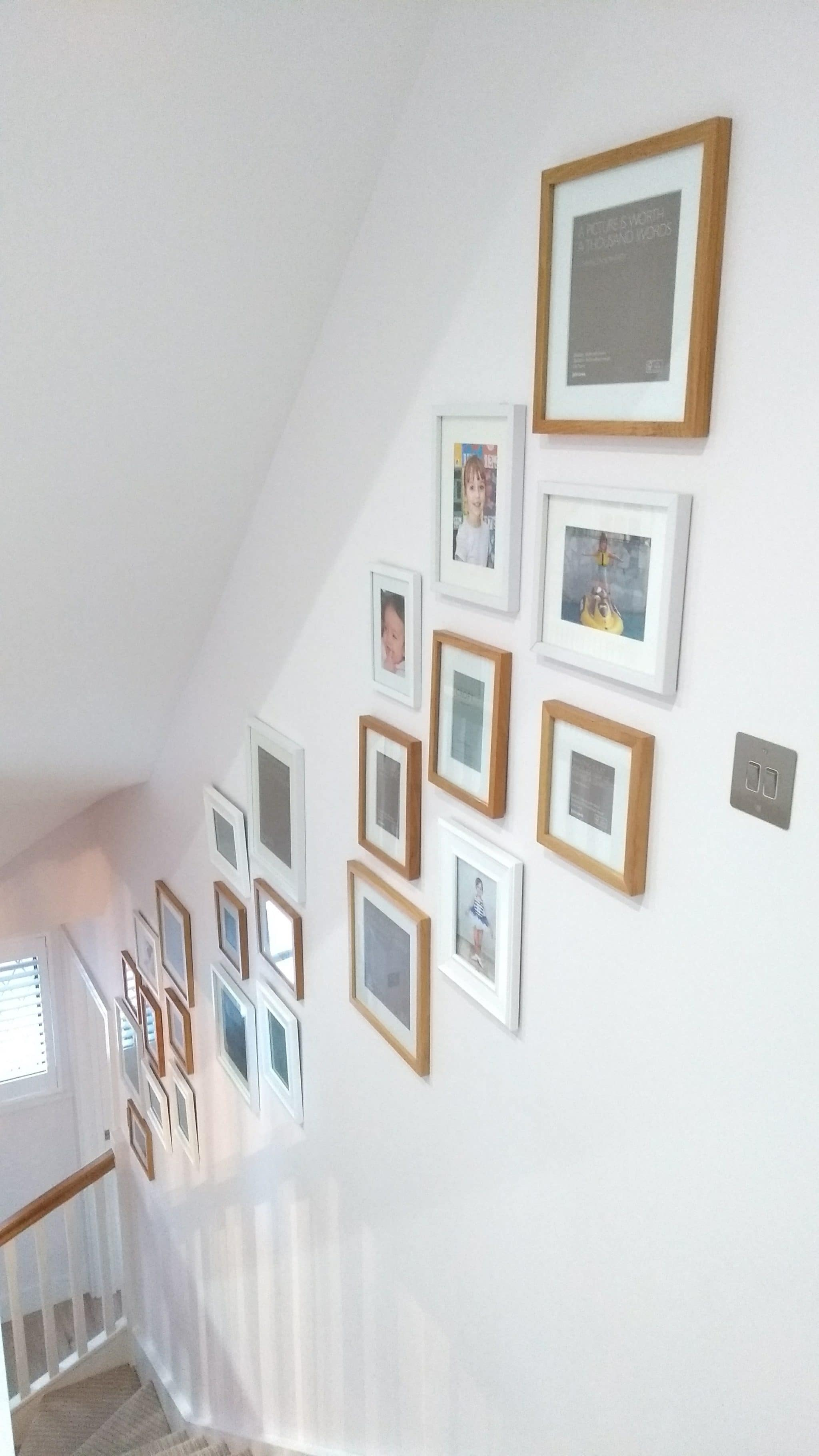 A 25 picture collage wall running along the staircase in Sevenoaks, Kent.